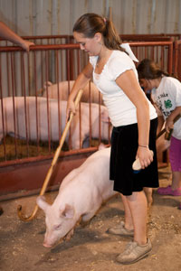 girl leading swine